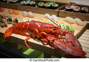 close up of big lobster on wood tray