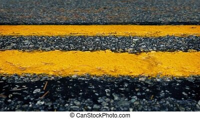 Passing Yellow Road Lines Closeup - Moving alongside yellow...