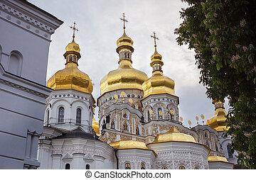 Kiev-Pechersk Lavra. Domes of the Uspensky cathedral in...