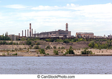 Panoramic view of ironworks on river coastline