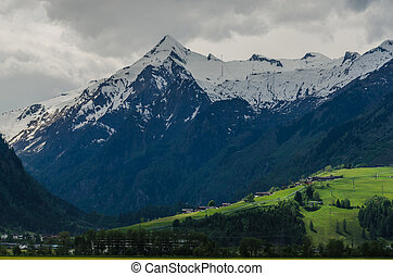 high mountain peak with snow in summer