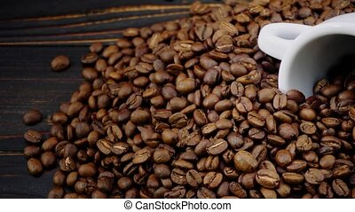 roasted coffee beans on wooden background - roasted coffee...