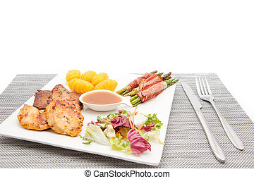 main dish with meat - an main dish with meat with sauce and...