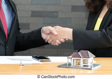 Customer shakes hands and agreement with a real estate agent...