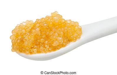 yellow caviar of pike fish in ceramic spoon - salty yellow...