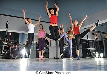 group of girls jumping in air - gorup of girls in fitness...