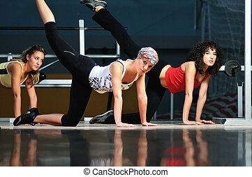 group of women working out in