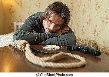 Desperate man choose commit suicide method. Suiside concept.