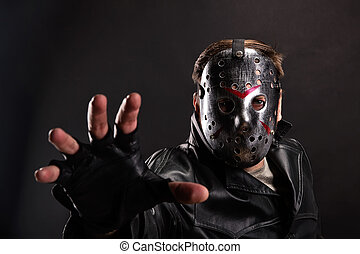 Maniac in hockey mask on dark background - Serial maniac in...