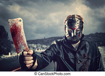 Butcher in hockey mask with bloody meat cleaver - Butcher in...