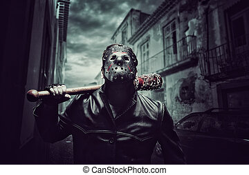 Psycho man in hockey mask with bloody baseball bat - Angry...