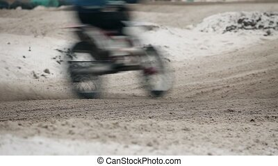 motorcycle rides on motocross track in winter side view...