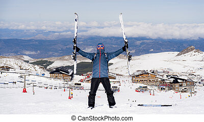 happy man happy in snow mountains at Sierra Nevada ski...