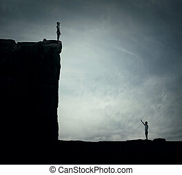 ADVERSITY - Conceptual image with two lost persons standing...