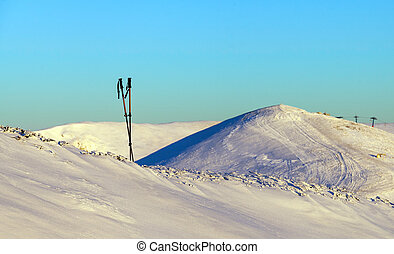 A pair of ski sticks in the mountains. - A pair of ski...
