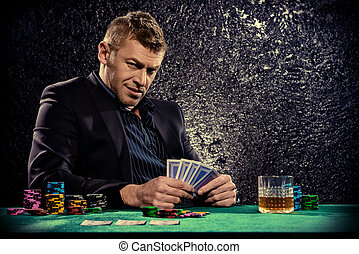 try your luck - A wealthy mature man drinking brandy and...
