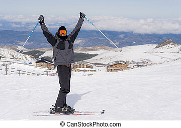 happy man happy in snow mountains at Sierrna Nevada ski...