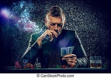 risky decision - Rich gambler man with the cards and chips...
