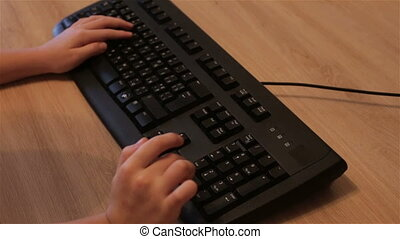 A child pushes a button on the keyboard