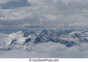 high mountain chain with many mountains and snow