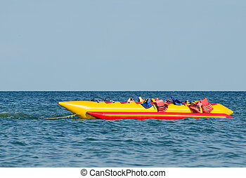 Empty water banana, with lifejackets in sea water attraction