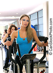 Women working out on spinning bikes at the gym - pretty...