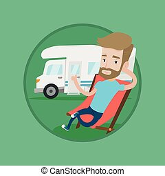 Man sitting in chair in front of camper van. - Hipster man...