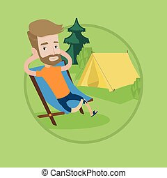 Man sitting in folding chair in the camp. - Happy hipster...