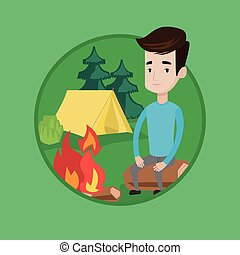 Man sitting on log near campfire in the camping.