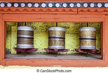 Praying wheels - Buddhist praying wheels at a monastery in...