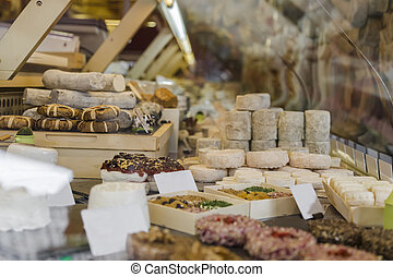 Large selection of different cheeses at the counter of a...