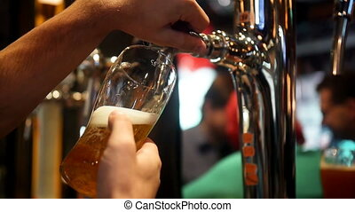 Bartender pouring draft beer. Night club 1080