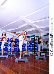 girls stepping in a fitness center - group of young girls...