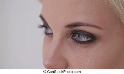 Close up of young woman's eyes. White background. Beauty,...