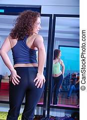 girl with attractive buttom in fitness studio - pretty girl...