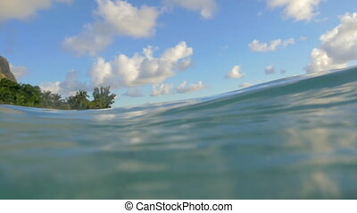 Clear blue ocean water and tropical island - Slow motion...