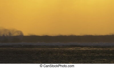 Ocean view with crushing waves at sunset - Slow motion of...