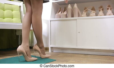 beautiful girl choosing a pair of high heels shoes....