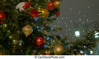 Christmas fir-tree decorated with New Year's ball. Holiday...