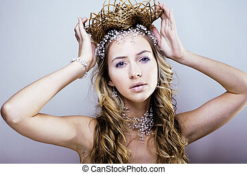 beauty young snow queen with hair crown on her head, complicate