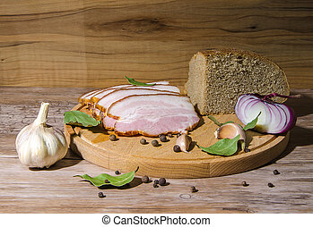 lard and bread with spice on cutting board