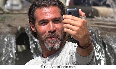Man Taking Selfy Using Cell Phone