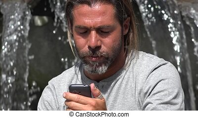 Confused Man Using Smartphone