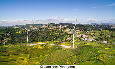 Wind power plants on a green hills aerial drone - Wind power...