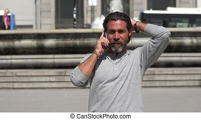 Man Walking While Talking On Phone