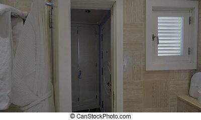 Closing bathroom door in the hotel