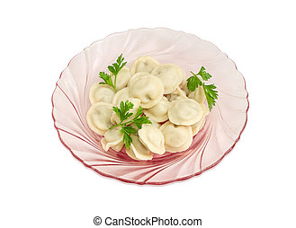 Cooked pelmeni on pink glass dish on a light background -...