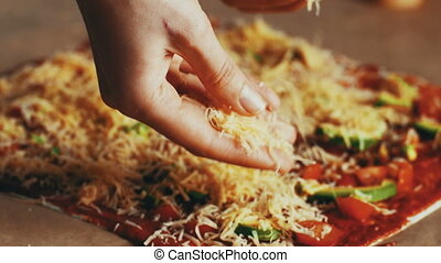 Close up woman making pizza in home kitchen for hobby,,...