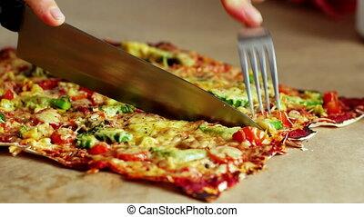 Slicing home made original Italian pizza, 4k close up.