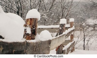 Rustic fence under the snow at winter - Rustic fence under...
